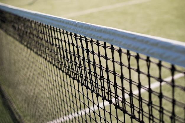 Close-up tennis net in a tennis court