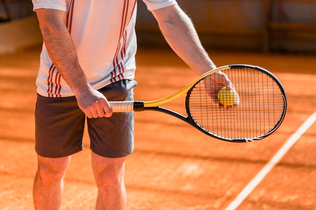 Close up of tennis player with racket