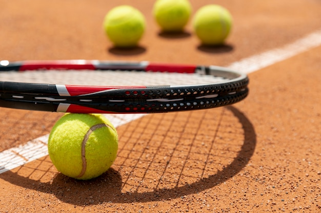 Close-up tennis racket over ball
