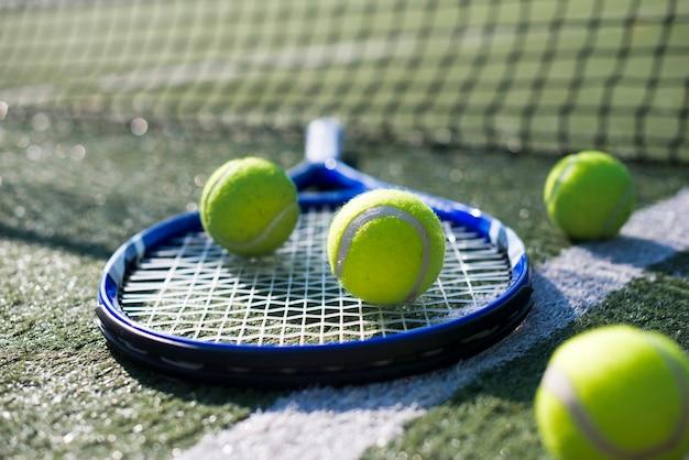Close-up tennis racket and balls