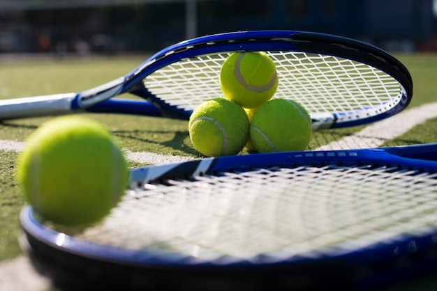 Close-up tennis rackets and balls