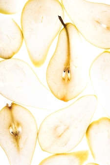Close up texture of backlit illuminated pear slices autumn food concept background