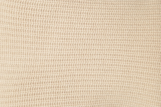 Close-up texture beige fabric  knitted wool
