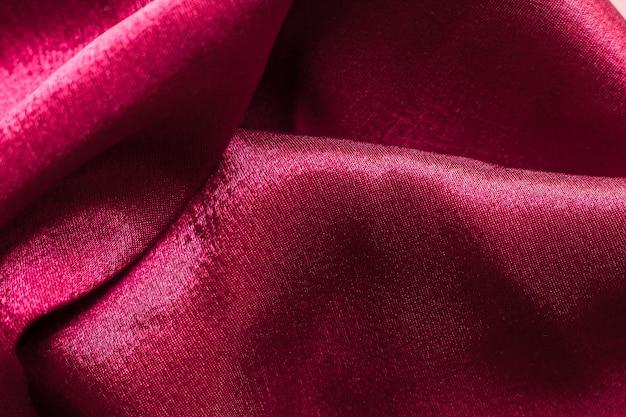 Текстура крупного плана бордовой ткани костюма