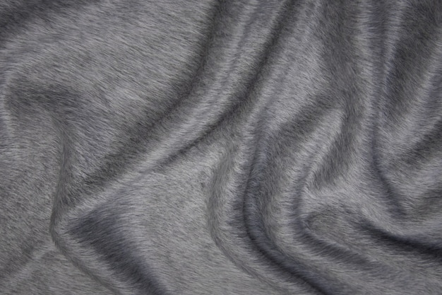 Close up texture of fabric for coat. gray woolen fabric. gray background.