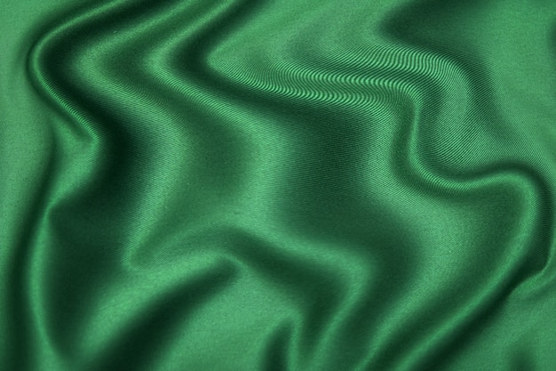 Close-up texture of natural green or brown fabric or cloth in same color. fabric texture of natural cotton, silk or wool, or linen textile material. color canvas background.