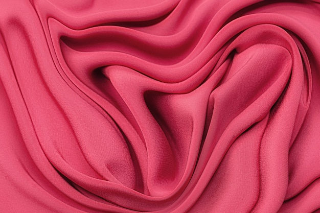 Close-up texture of natural red or crimson or pink  fabric. fabric texture of natural cotton, silk or wool, or linen textile material. red and orange canvas background.