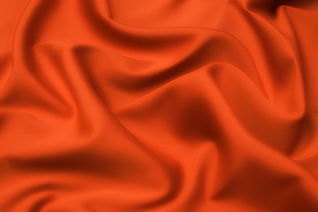 Close-up texture of natural red or orange fabric or cloth in same color.