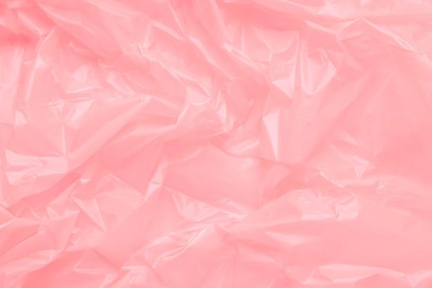 ピンクのプラスチックゴミ袋のテクスチャをクローズアップ
