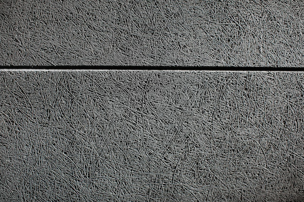 灰色の吸音パネルが取り付けられた壁のテクスチャを閉じる