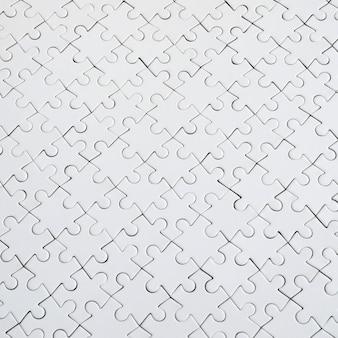 白いジグソーパズルのテクスチャを閉じる