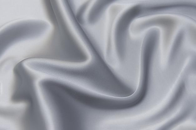 코트 직물의 질감을 닫습니다. 회색 모직 직물. 회색 배경입니다.