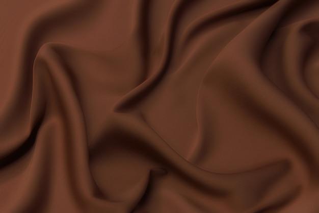 ナチュラルベージュの生地や茶色の布のクローズアップテクスチャ。天然コットンまたはリネンテキスタイル素材の生地の質感。ベージュのキャンバスの背景。