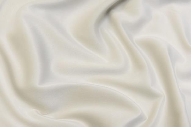 Крупный план текстуры натуральной бежевой ткани или ткани коричневого цвета. фактура ткани из натурального хлопкового или льняного текстильного материала. бежевый фон холста.