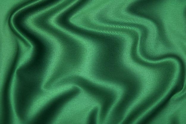 동일한 색상의 천연 녹색 또는 갈색 직물 또는 천의 클로즈업 질감. 천연 면, 실크 또는 양모 또는 린넨 섬유 소재의 패브릭 질감. 컬러 캔버스 배경입니다.