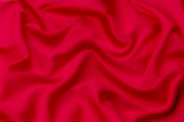 Крупный план текстуры натурального красного цвета. фактура ткани из натурального хлопка, шелка или шерстяного материала.