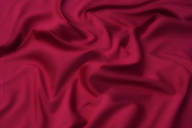 Крупный план натуральной красной или оранжевой ткани или ткани того же цвета.