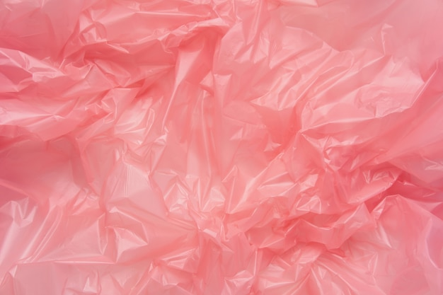 Close up texture of a pink plastic garbage bag