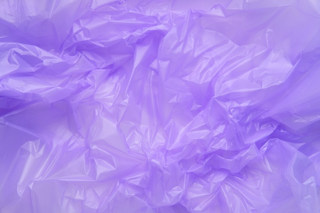 Close up texture of a purple plastic garbage bag