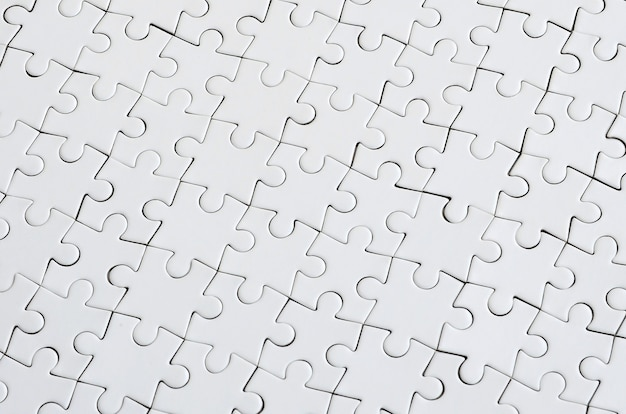 Close up texture of a white jigsaw puzzle in assembled condition