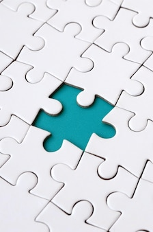 Close-up texture of a white jigsaw puzzle in assembled state