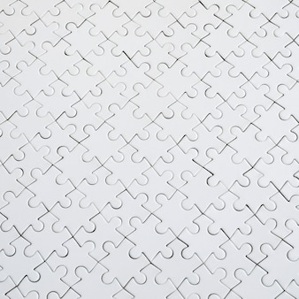Close up texture of a white jigsaw puzzle