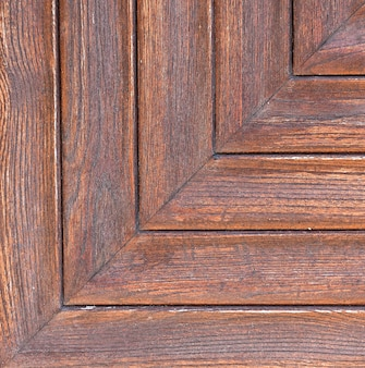 The close up texture of a wooden board.