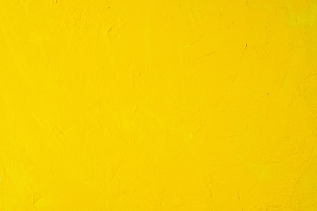 Close up texture yellow color paint on canvas brush marks stroke background