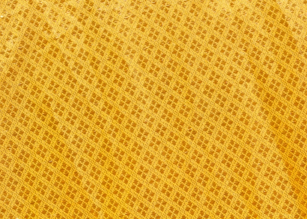 Close up texture of yellow robe