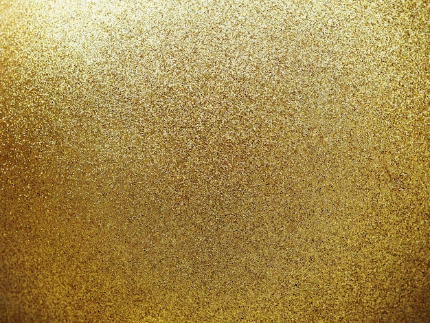 Close up textured of golden round ball with glitter.
