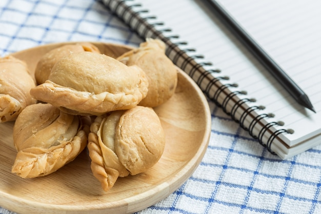Close up thai curry puff on wooden dish