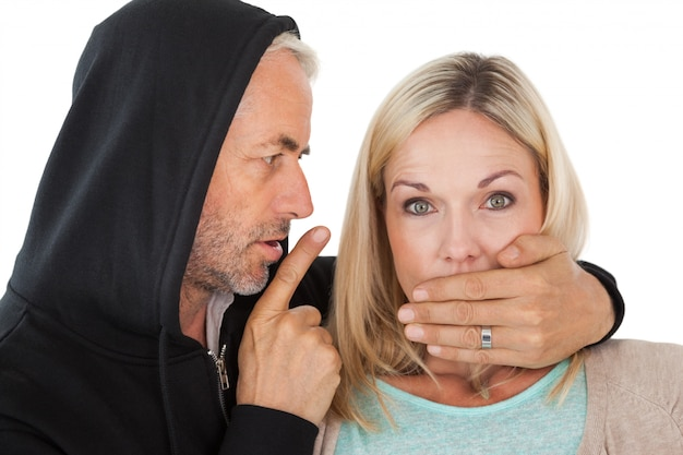 Close up of theft covering woman's mouth