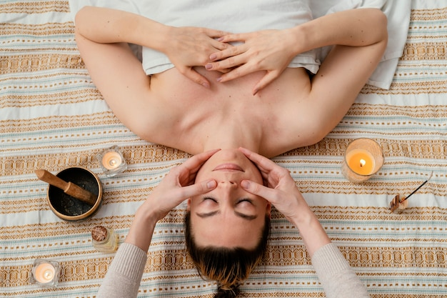 Close up therapist massaging cheeks