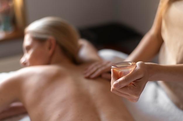 Close-up therapist massaging woman Free Photo