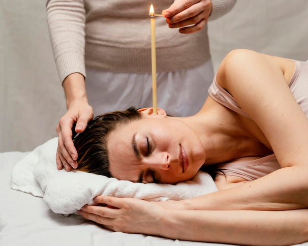 Close up therapist using candle