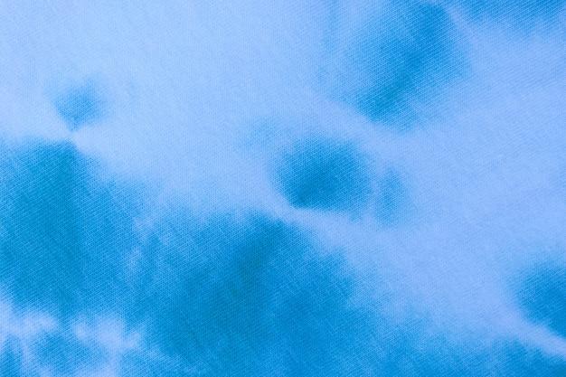 Закройте вверх по узору ткани красителя галстука ручной работы текстуры