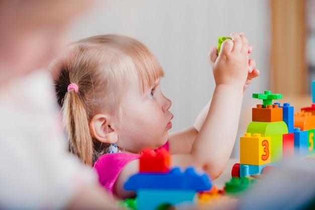 Close-up toddler girl playing