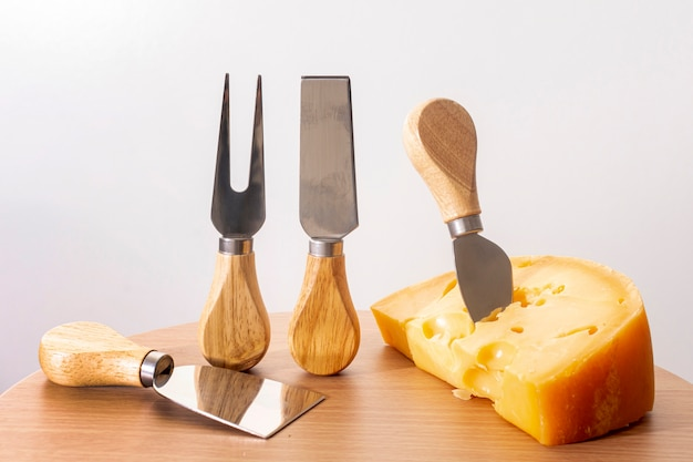 Close-up tools with slice of cheese on a table
