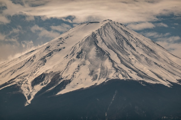 Close up top of fuji mountain with snow cover on the top with could, fujisan