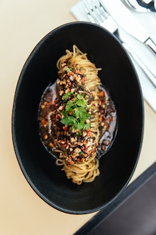 Close up top view of capellini cold pasta with hikiji seaweed