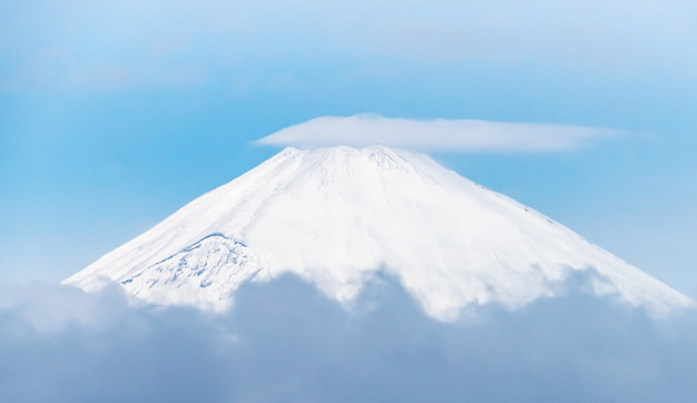 Close up top view of fuji mountain with snow cover with could