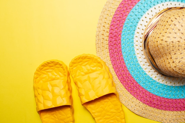 Close-up top view of woman summer hat and slippers
