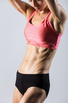 Close-up of torso of beautiful athletic woman
