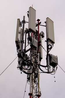 Close-up of tower with 5g and 4g cellular network antenna