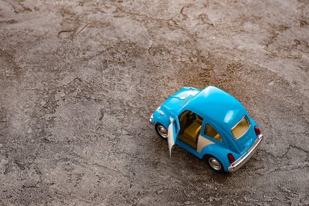 Close up of toy a retro car model  with opening door on a color background