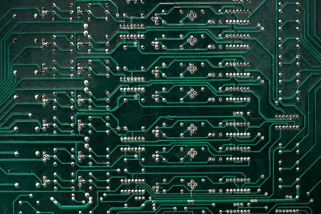 Close up - the tracks on the green motherboard .