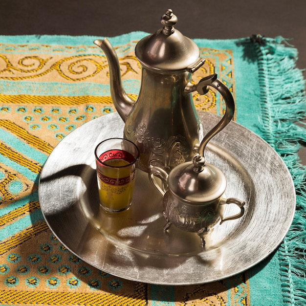 Close-up traditional arabic hot tea on prayer rug