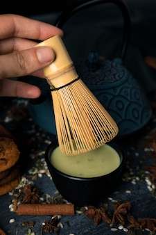 Close-up of traditional asian whisk