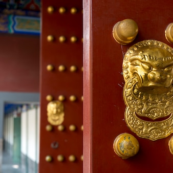 Close-up of a traditional chinese red door, hall of dispelling clouds, longevity hill, summer palace
