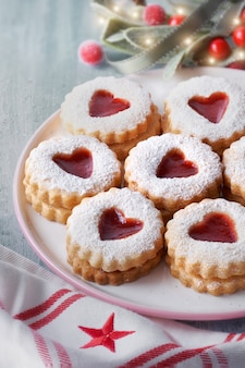 Close up on traditional christmas linzer cookies filled with strawberry jam